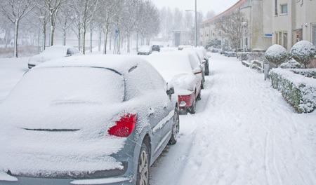 Snowy street in a city in winter Stockfoto