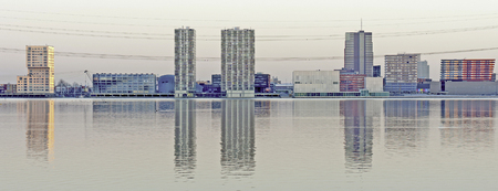 almere: Skyline of a city along a lake at dawn