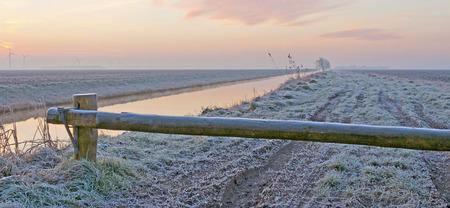 winter sunrise: Sunrise over a canal in winter Stock Photo