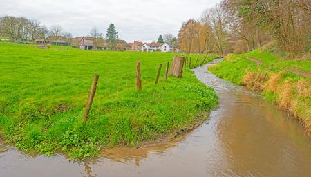 meandering: Stream meandering through a rural landscape