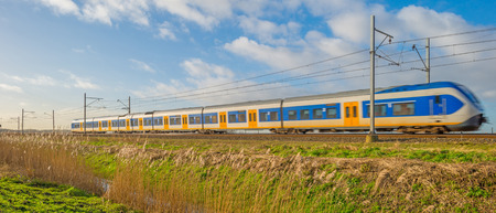 almere: Electric train driving through nature in winter Stock Photo