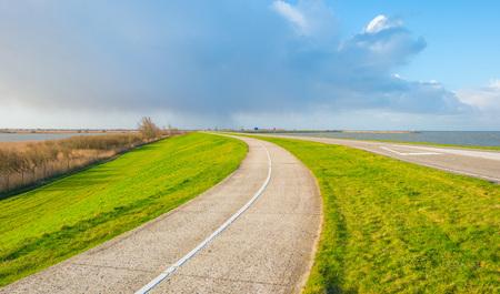 Road on a dike along a lake