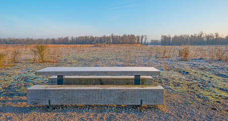 wooden bench: Frozen wooden bench in nature Stock Photo