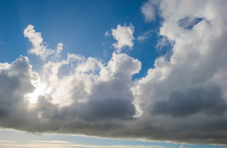 tranquil atmosphere: Clouds in a blue sky in winter Stock Photo
