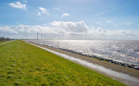 dike: Dike along a stormy sea in spring