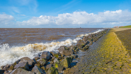 stormy sea: Dike along a stormy sea in spring