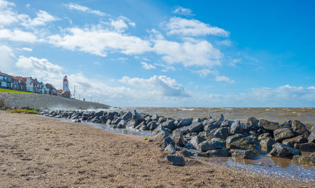 stormy sea: Lighthouse along a stormy sea in spring Stock Photo