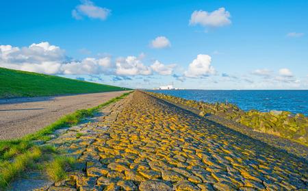 flevoland: Dike along a lake in spring Stock Photo