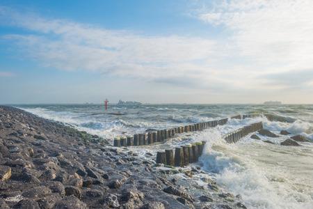 stormy sea: Breakwater in a stormy sea in summer