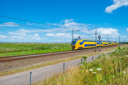 Railroad through a natural park in summer Editorial
