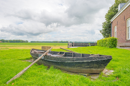 Wooden boat floating above a former sea in summer