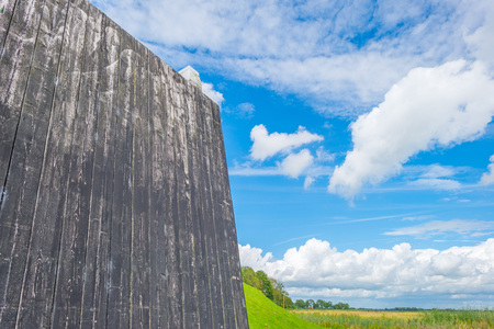 Wooden wall protecting an island against a former sea Stock Photo