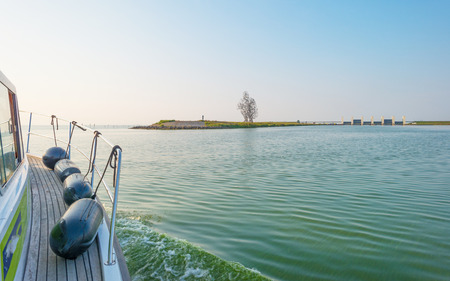 markermeer: Boat sailing on a lake at sunset in summer Stock Photo