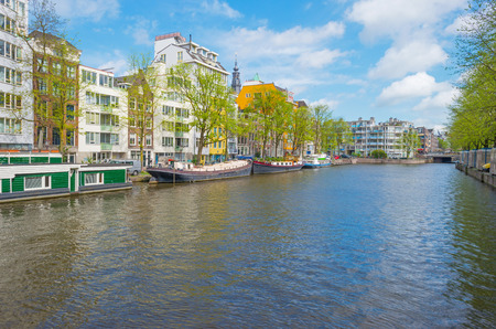 Canal in Amsterdam in sunlight in spring Stock Photo