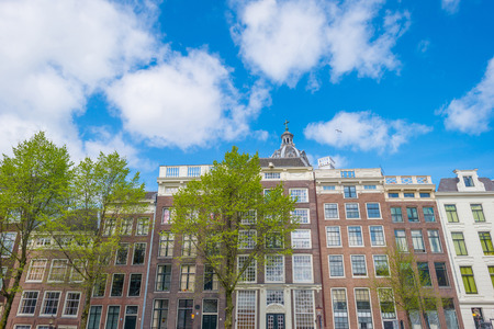 Merchants houses in Amsterdam in sunlight in spring