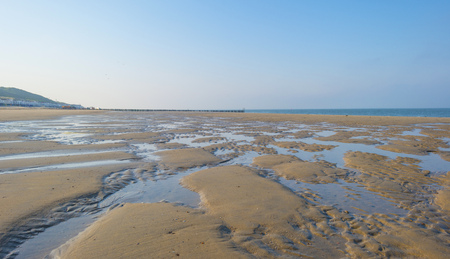 Recreational beach along the North Sea below a blue sky in spring