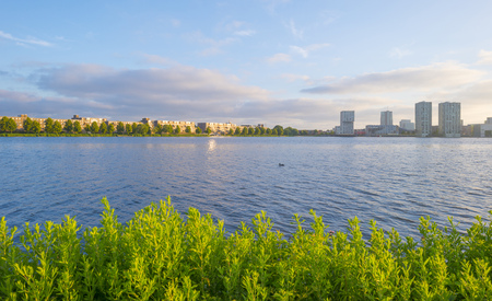 Skyline of a city along the shore of a lake at sunrise in spring Stockfoto - 103549716