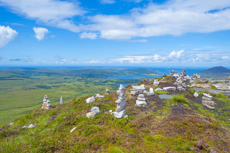 Panorama of mountains, marshy land and heathland or Connemara National Park in Ireland in summer