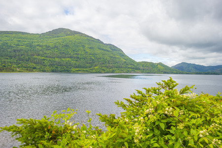 Panorama of hills, shore and surroundings of a lake in a national park in Ireland Stock Photo