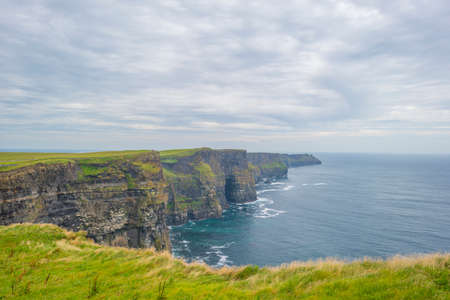 Cliffs of Moher along the Atlantic Ocean in summer