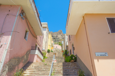 View of the town of Castelsardo on a hill and along the sea in sunlight in spring Editorial