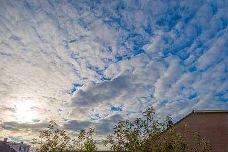 Clouds in a blue sky over a city in bright sunlight in autumn, Almere, Flevoland