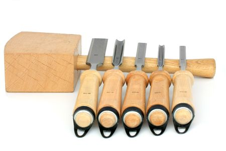 carving tool: hammer ang five different chisels isolated on white