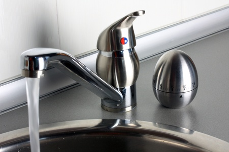 Flowing kithen faucet and running timer
