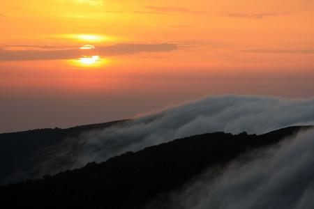 majestic mountain sunrise with mist lake waterfall Stock Photo - 8860305