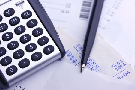 A calculator, pen, and financial statement, blue tone Standard-Bild