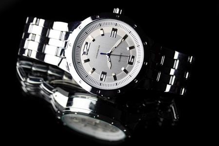 Wrist watch lying on dark background