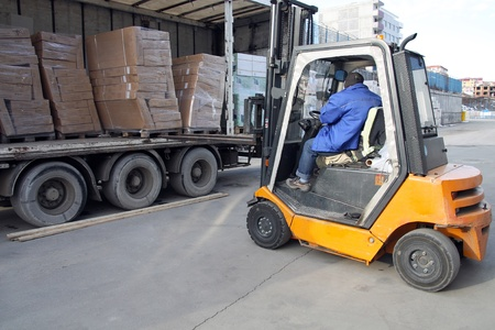 Forklift operator loading on a truck.