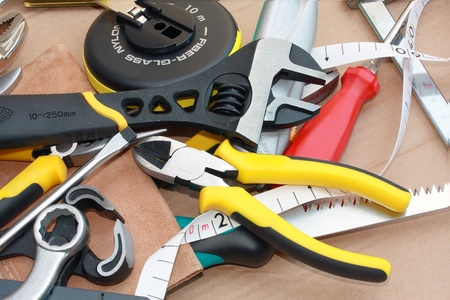 a lots of messy work tools photo