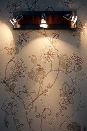 spoted: three spoted wall lamp on wallpaper