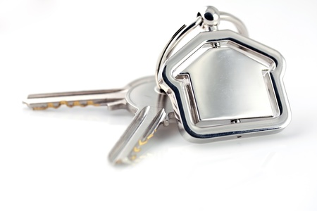 color key: Macro view of two silver keys with house figure on the white background Stock Photo