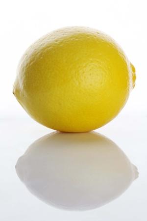 reflektion: single lemon with reflektion Stock Photo