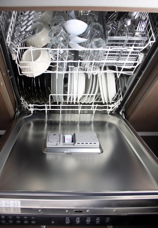 full dishwafher, focus on dishwasher detergent talbet photo