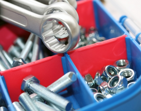 a set of spanners in front of toolbox of bolts and nuts Stock Photo - 13812131