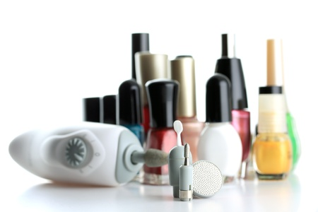 Manicure Set in front of nial polish bottles photo