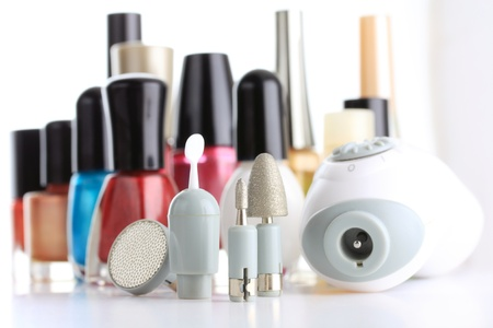 Manicure Set in front of nail polish bottles photo