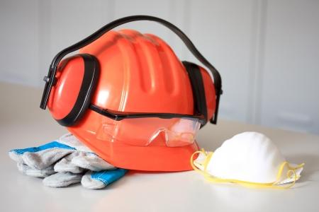 Orange hard hat, earphones,  gloves, Face Mask and goggles