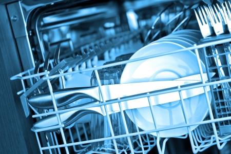 Dishwasher after cleaning process, blue tone Standard-Bild