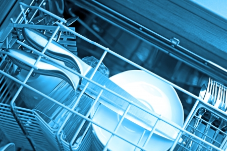 Dishwasher after cleaning process, blue tone Stock Photo - 17630765