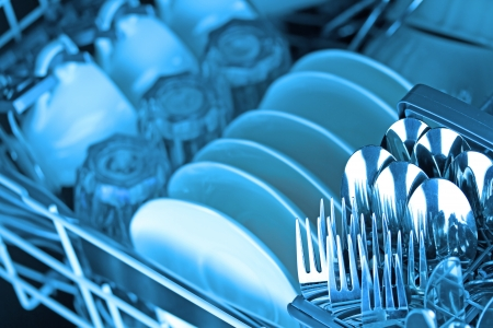 dishwasher: Dishwasher after cleaning process, blue tone Stock Photo
