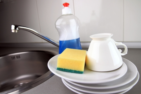 clean dishes: clean dish-ware, detergent and sponge