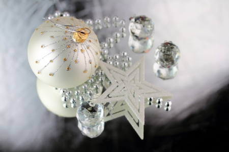 Christmas baubles, Cristal sphere and star on silver background with reflections