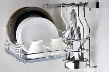 clean dishware, knife and forks in front of plates