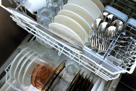 Dishwasher after cleaning process, selective focus with copy space
