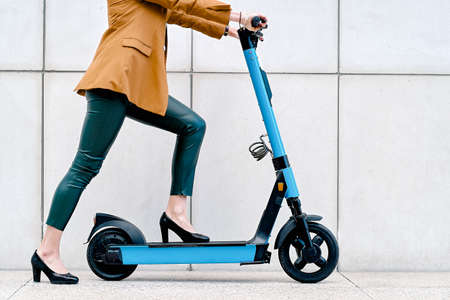 Young woman using a rental electric scooter in the city Zdjęcie Seryjne