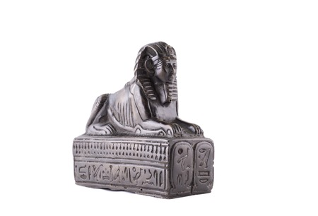 Statuette of the Egyptian sphinx made of stone on a white background
